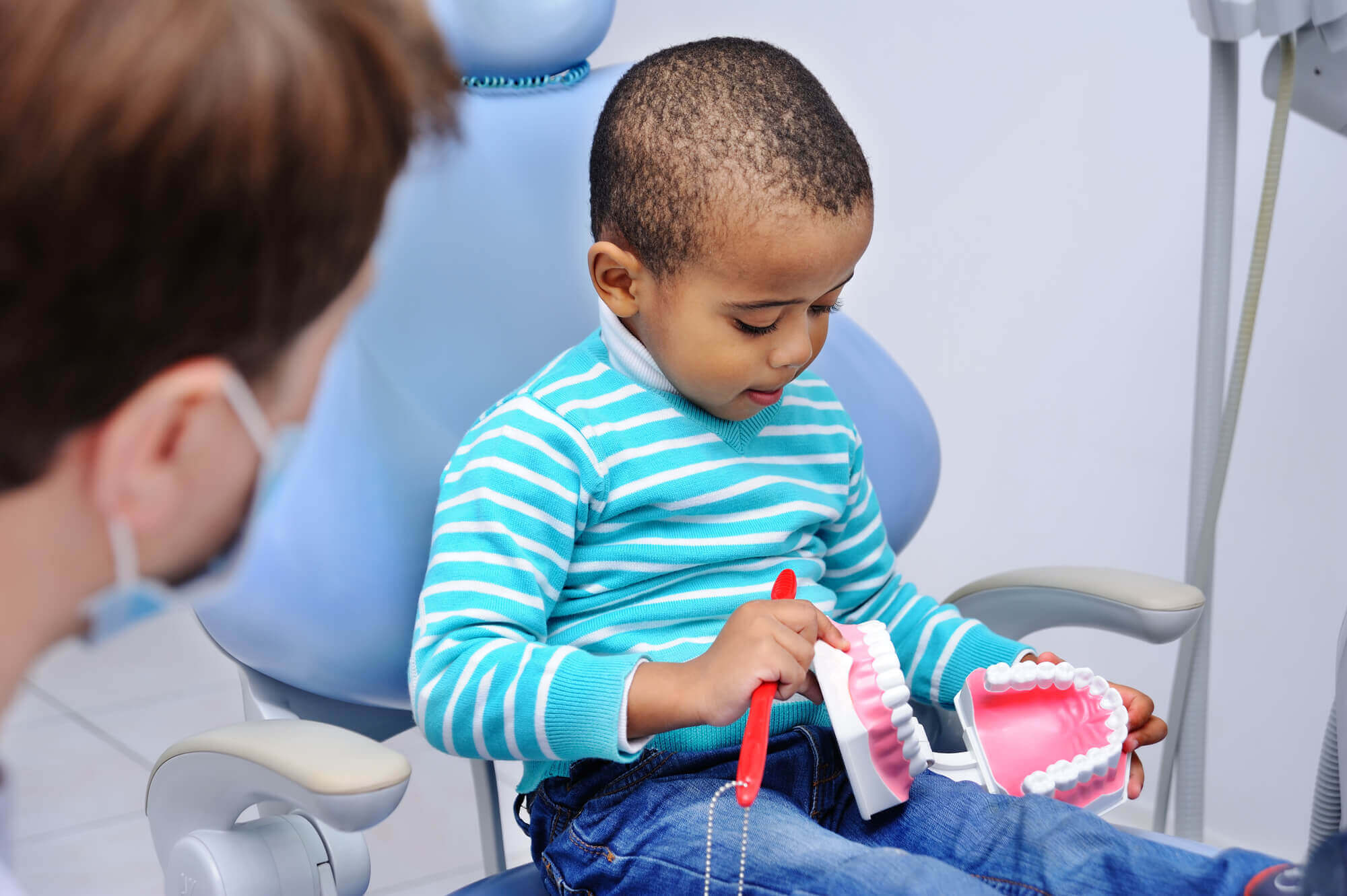 Cute Baby In The Dental Chair Learning about Brushing and Flossing from Dentist