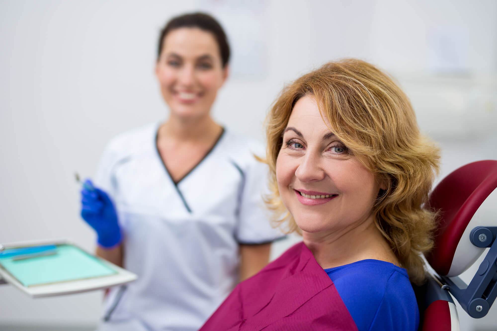 Portrait Of Cheerful Mature Woman And Dentist